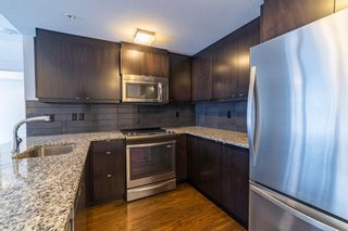 Photo 3: 14 45 Aspenmont Heights SW in Calgary: Aspen Woods Apartment for sale : MLS®# A1118971