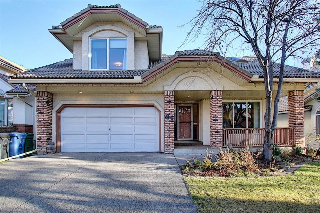 Main Photo: 84 Strathdale Close SW in Calgary: Strathcona Park Detached for sale : MLS®# A1046971