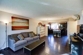 Photo 4: 104 AUBURN BAY Street SE in Calgary: Auburn Bay Semi Detached for sale : MLS®# C4254127