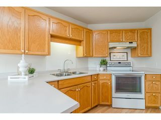 """Photo 7: 204 5375 205 Street in Langley: Langley City Condo for sale in """"Glenmont Park"""" : MLS®# R2500306"""