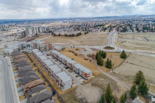 Photo 42: 145 Shawnee Common SW in Calgary: Shawnee Slopes Row/Townhouse for sale : MLS®# A1097036