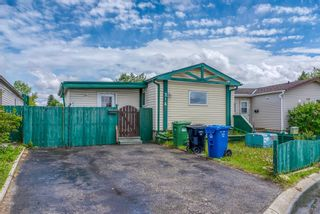Photo 3: 214 Erin Woods Circle SE in Calgary: Erin Woods Detached for sale : MLS®# A1120105