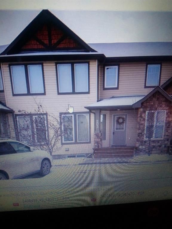 Main Photo: 203 2445 Kingsland Road SE: Airdrie Row/Townhouse for sale : MLS®# A1076272