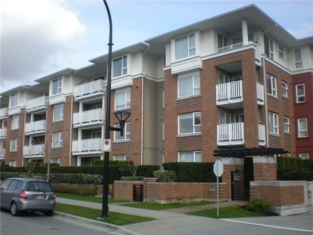 Corner garden unit with spacious fenced yard and patio