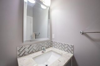 Photo 21: 48 Tremblant Terrace SW in Calgary: Springbank Hill Detached for sale : MLS®# A1131887