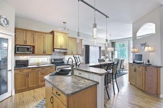 Photo 5: 31 Strathlea Common SW in Calgary: Strathcona Park Detached for sale : MLS®# A1147556
