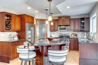 Photo 11: 63 Springbluff Boulevard SW in Calgary: Springbank Hill Detached for sale : MLS®# A1131940