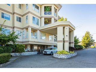 "Photo 2: 302 20120 56 Avenue in Langley: Langley City Condo for sale in ""Blackberry Lane 1"" : MLS®# R2506243"