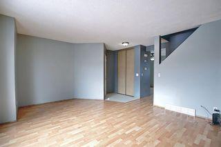 Photo 5: 109 Falmere Way NE in Calgary: Falconridge Detached for sale : MLS®# A1096389