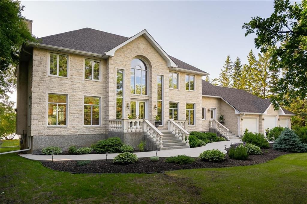 Welcome to 4034 Henderson. Stunning stone curb appeal with stone exterior. Riverfront property. Meticulously maintained 2.95 acres.