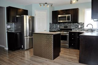 Photo 7: 8 WOODSIDE Circle NW: Airdrie House for sale : MLS®# C4130455