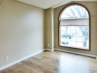Photo 4: 107 Mt Allan Circle SE in Calgary: McKenzie Lake Detached for sale : MLS®# A1068557