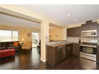 Photo 4: 149 SUNSET Common: Cochrane Residential Attached for sale : MLS®# C3631506
