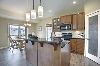 Photo 12: 562 Panatella Boulevard NW in Calgary: Panorama Hills Detached for sale : MLS®# A1145880