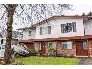 Photo 1: 7541 17TH AVENUE - LISTED BY SUTTON CENTRE REALTY in Burnaby: Edmonds BE 1/2 Duplex for sale (Burnaby East)  : MLS®# R2030562