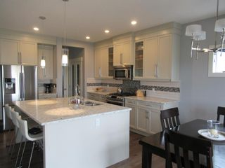 Photo 7: 1447 Aldrich Place: Carstairs Detached for sale : MLS®# A1130977