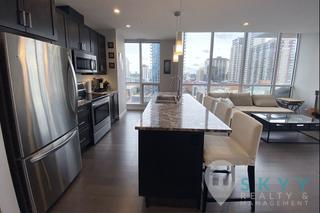 Photo 2: 10238 103 Street in Edmonton: Condo for rent