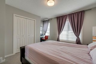 Photo 25: 235 ASCOT Circle SW in Calgary: Aspen Woods Row/Townhouse for sale : MLS®# A1025064