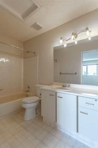 Photo 21: #34 5810 PATINA DR SW in Calgary: Patterson House for sale : MLS®# C4138541