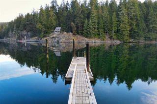 "Photo 1: 9858 WESCAN Road in Halfmoon Bay: Halfmn Bay Secret Cv Redroofs House for sale in ""Secret Cove"" (Sunshine Coast)  : MLS®# R2555031"
