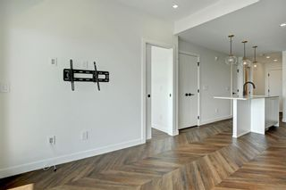 Photo 10: 604 8445 Broadcast Avenue SW in Calgary: West Springs Apartment for sale : MLS®# A1146296