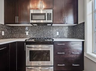 Photo 18: 27 Aspen Hills Common SW in Calgary: Aspen Woods Row/Townhouse for sale : MLS®# A1134206