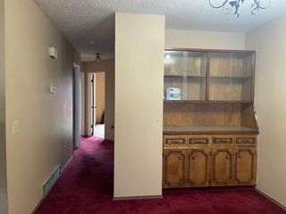 Photo 5: 40 TEMPLEBY Way NE in Calgary: Temple Semi Detached for sale : MLS®# A1126559