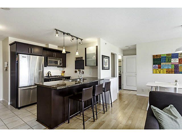 """Photo 1: Photos: 404 1650 W 7TH Avenue in Vancouver: Fairview VW Condo for sale in """"VIRTU"""" (Vancouver West)  : MLS®# V1079673"""
