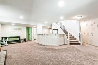 Photo 23: 64 strathlea Place SW in Calgary: Strathcona Park Detached for sale : MLS®# A1117847