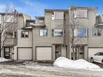 Main Photo: 154 Glamis Terrace SW in Calgary: Glamorgan Row/Townhouse for sale : MLS®# A1076032