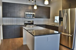 Photo 7: 1 711 17 Avenue NW in Calgary: Mount Pleasant Row/Townhouse for sale : MLS®# A1100885