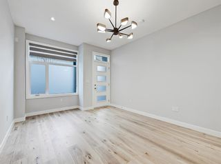 Photo 5: 105 408 27 Avenue NE in Calgary: Winston Heights/Mountview Row/Townhouse for sale : MLS®# A1089624