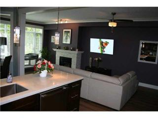 """Photo 2: 105 3600 WINDCREST Drive in North Vancouver: Roche Point Townhouse for sale in """"RAVEN WOODS"""" : MLS®# V1101013"""