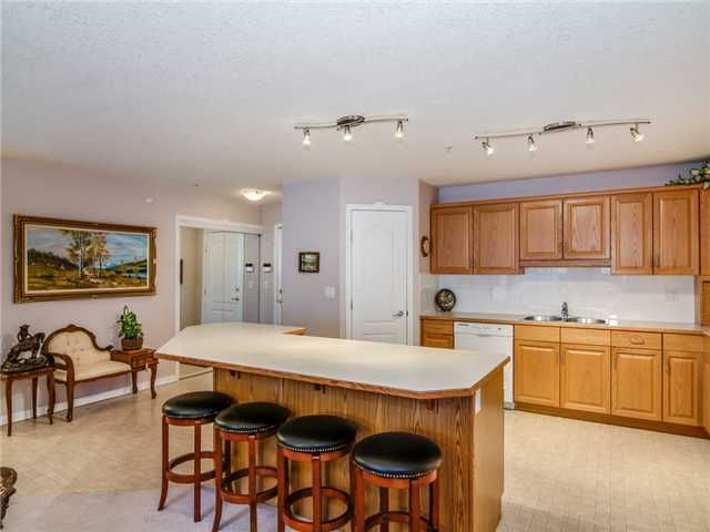 Photo 4: Photos: 1201 303 ARBOUR CREST Drive NW in Calgary: Arbour Lake Condo for sale : MLS®# C3650981