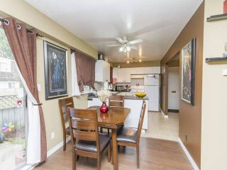 """Photo 1: 44 21555 DEWDNEY TRUNK Road in Maple Ridge: West Central Townhouse for sale in """"RICHMOND COURT"""" : MLS®# R2057470"""