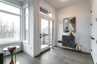 Photo 3: 102 Valour Circle SW in Calgary: Currie Barracks Detached for sale : MLS®# A1073935