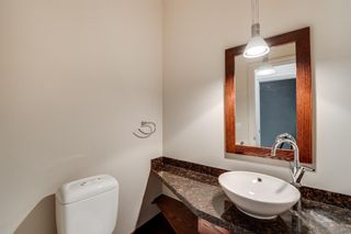 Photo 11: 29 Somme Boulevard SW in Calgary: Garrison Woods Row/Townhouse for sale : MLS®# A1129180