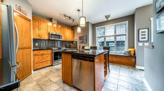 Photo 17: 38 Somme Boulevard SW in Calgary: Garrison Woods Row/Townhouse for sale : MLS®# A1112371