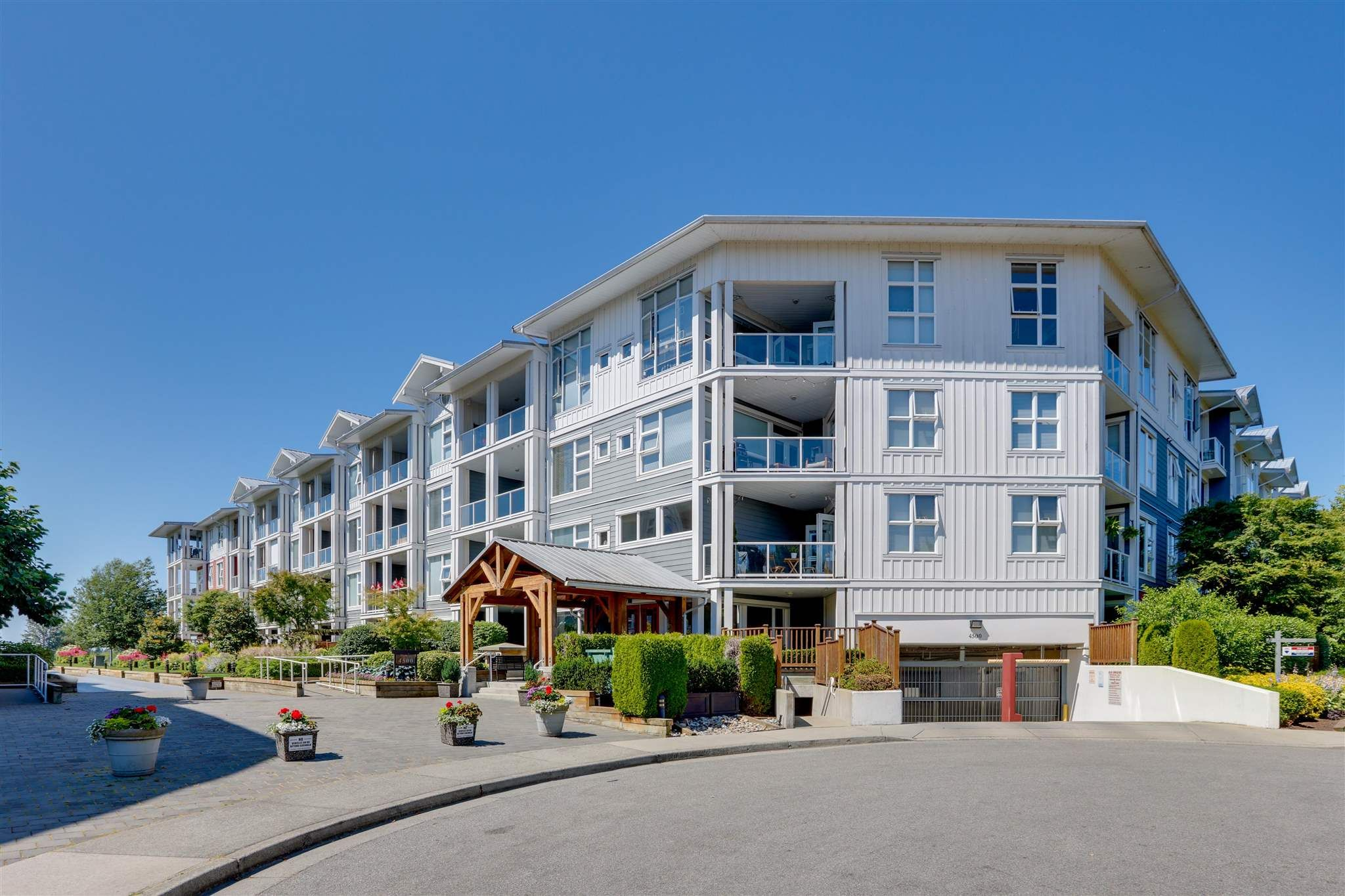 """Main Photo: 208 4500 WESTWATER Drive in Richmond: Steveston South Condo for sale in """"COPPERSKY WEST"""" : MLS®# R2599023"""