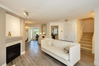 """Photo 3: 405 13900 HYLAND Road in Surrey: East Newton Townhouse for sale in """"HYLAND GROVE"""" : MLS®# R2605860"""