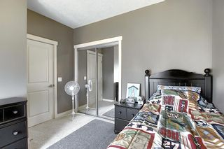 Photo 26: 47 WEST SPRINGS Lane SW in Calgary: West Springs Row/Townhouse for sale : MLS®# A1039919