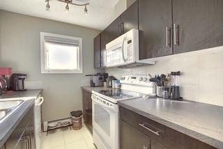 Photo 6: 2413 403 Mackenzie Way SW: Airdrie Apartment for sale : MLS®# A1052642