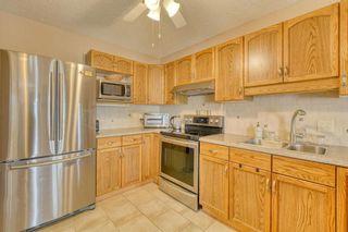 Photo 9: 124 Deer Ridge Close SE in Calgary: Deer Ridge Semi Detached for sale : MLS®# A1129488