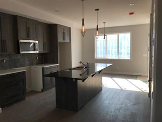 Photo 27: 23 Sunrise Heights: Cochrane Duplex for sale : MLS®# A1017998