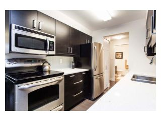 """Photo 5: 102 2299 E 30TH Avenue in Vancouver: Collingwood VE Condo for sale in """"TWIN COURT"""" (Vancouver East)  : MLS®# V1010933"""