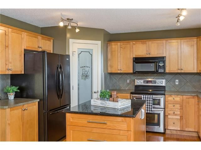 Photo 12: Photos: 664 LUXSTONE Landing SW: Airdrie House for sale : MLS®# C4106944