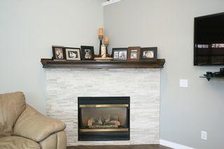 Photo 10: 306 WEST TERRACE Place: Cochrane House for sale : MLS®# C4117766