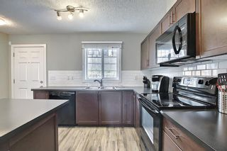 Photo 15: 144 Pantego Lane NW in Calgary: Panorama Hills Row/Townhouse for sale : MLS®# A1129273