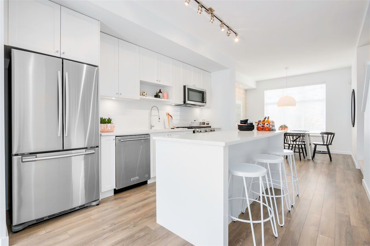 """Main Photo: 9 15487 99A Avenue in Surrey: Guildford Townhouse for sale in """"THE GREAT ONE"""" (North Surrey)  : MLS®# R2571992"""