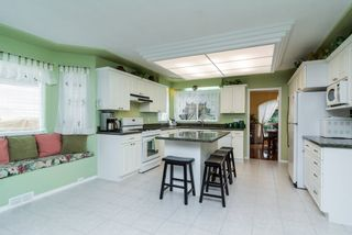 "Photo 4: 16901 FRIESIAN Drive in Surrey: Cloverdale BC House for sale in ""RICHARDSON RIDGE"" (Cloverdale)  : MLS®# R2025574"